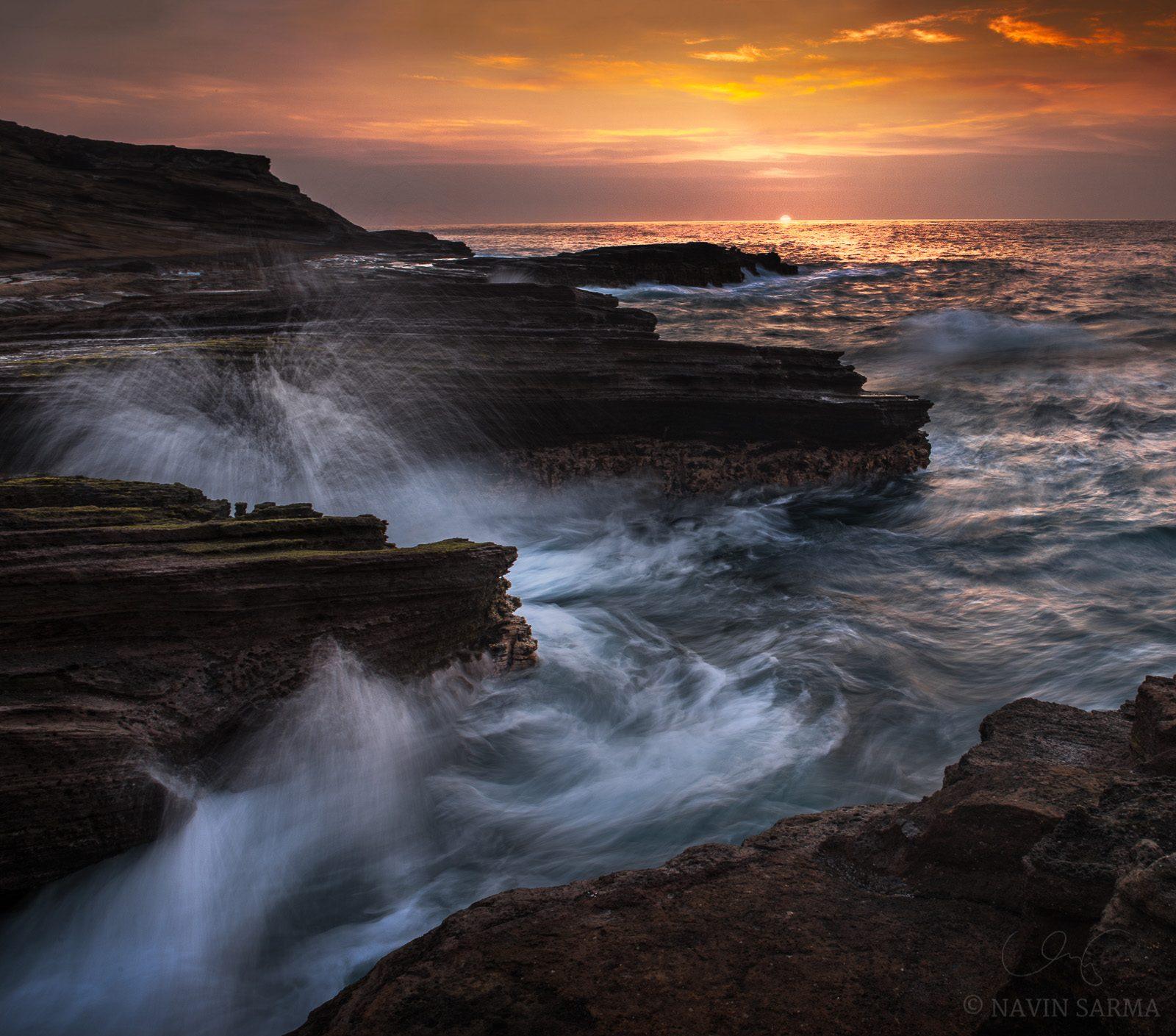Waves crash as the sun rises at Lanai lookoutWaves crash as the sun rises at Lanai lookout