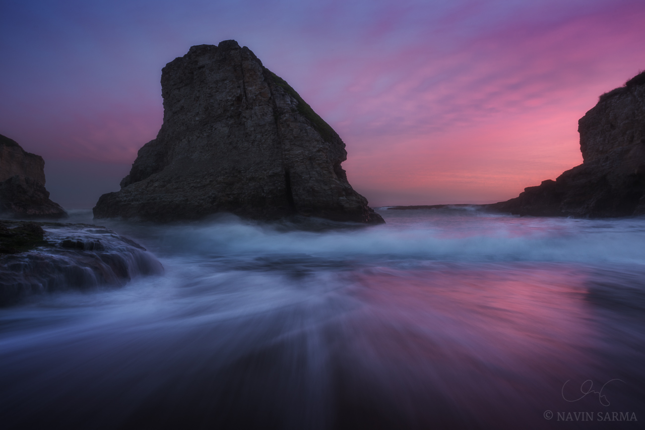 A blast of color through rough surf during an otherwise gray evening at Shark Fin Cove near Davenport, CA