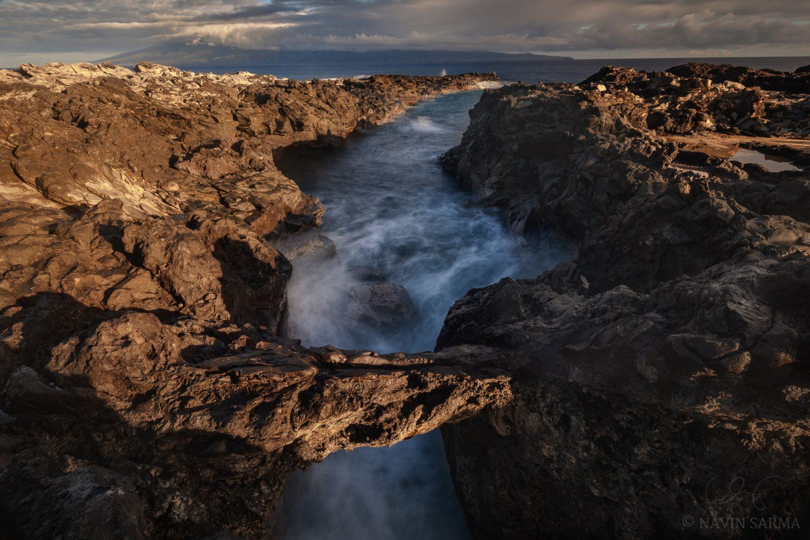 Rough seas cut through lava rock at Ironwoods beach, Maui
