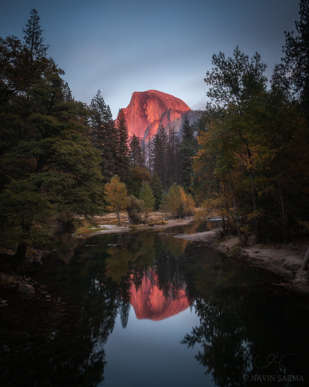A classic view of the reflection of late evening light over Half Dome