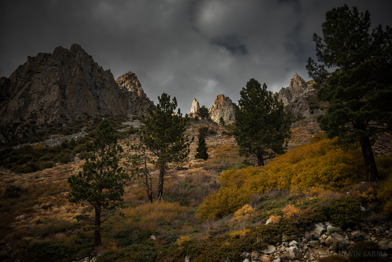Light peeks through clouds and on high crags near Yosemite